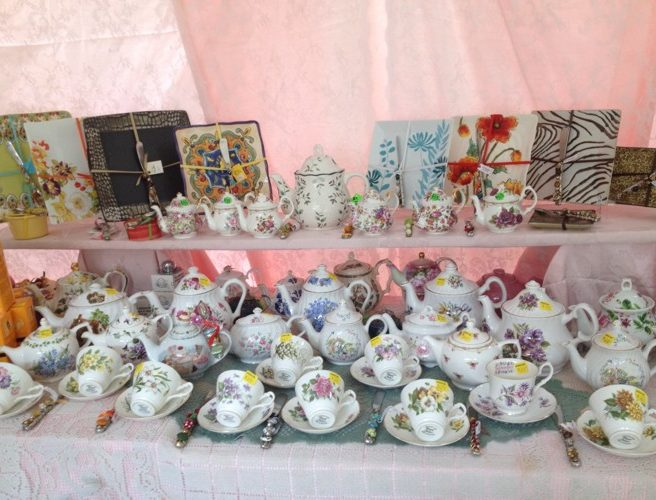 Teapots and teacups Many display 500px